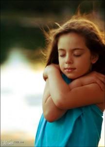 Girl hugging herself