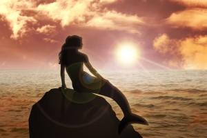 Mermaid Silouhette on Rock Ocean